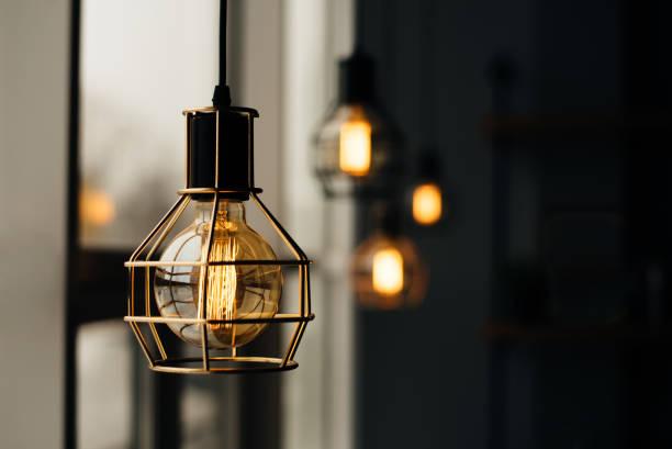 glowing light bulbs in the loft style - украшать стоковые фото и изображения