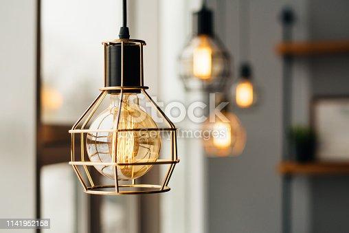 1137999886 istock photo Glowing light bulbs in the loft style 1141952158
