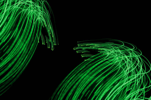 Glowing light trails - LED light painting (green) stock photo