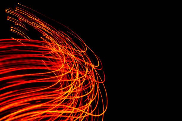 Glowing light trails - LED light painting (red) stock photo