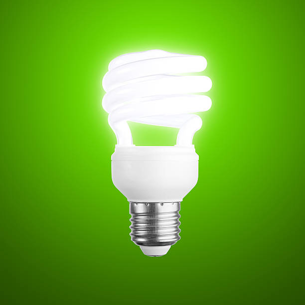 Glowing Lightbulb on Green + Clipping Path stock photo