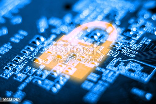 istock Glowing lock icon on the electronic Board with a microchip. Concept of information security technology 959531282