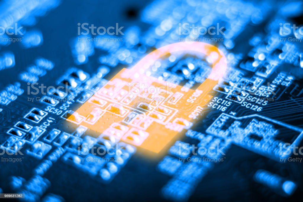 Glowing lock icon on the electronic Board with a microchip. Concept of information security technology stock photo