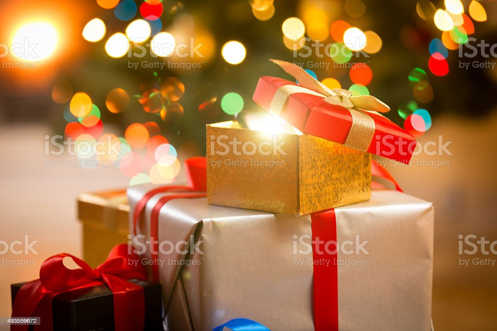 glowing magic Christmas gift boxes stock photo