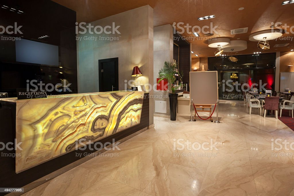Glowing marble reception desk stock photo