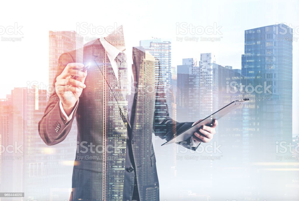 Glowing marker businessman, cityscape royalty-free stock photo