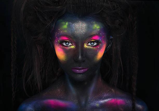 Glowing neon makeup with dramatic look. - foto de acervo