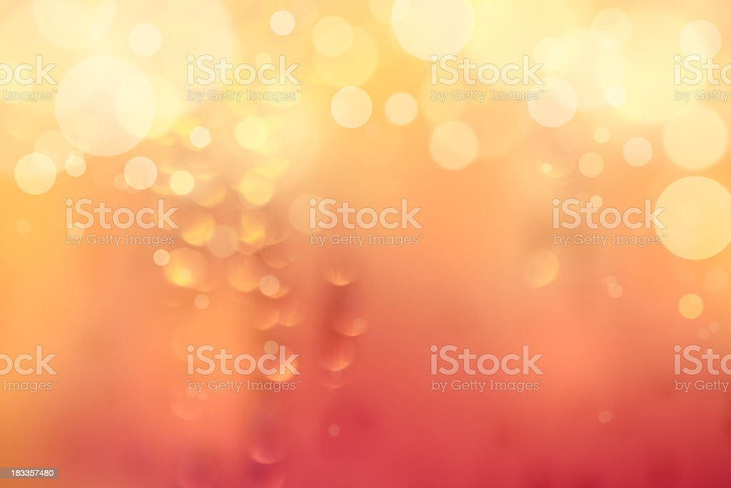 Glowing orange background with bubbles fading to yellow royalty-free stock photo