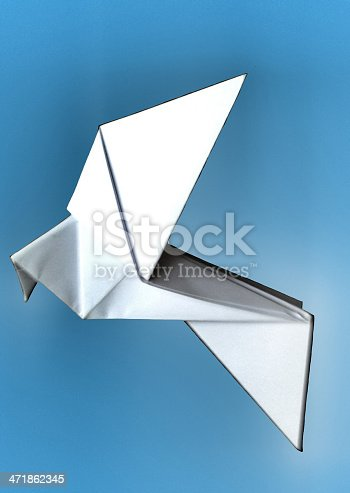istock glowing origami paper dove on blue background 471862345