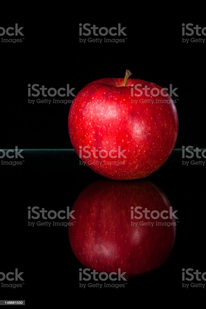 Glowing red apple on black stock photo
