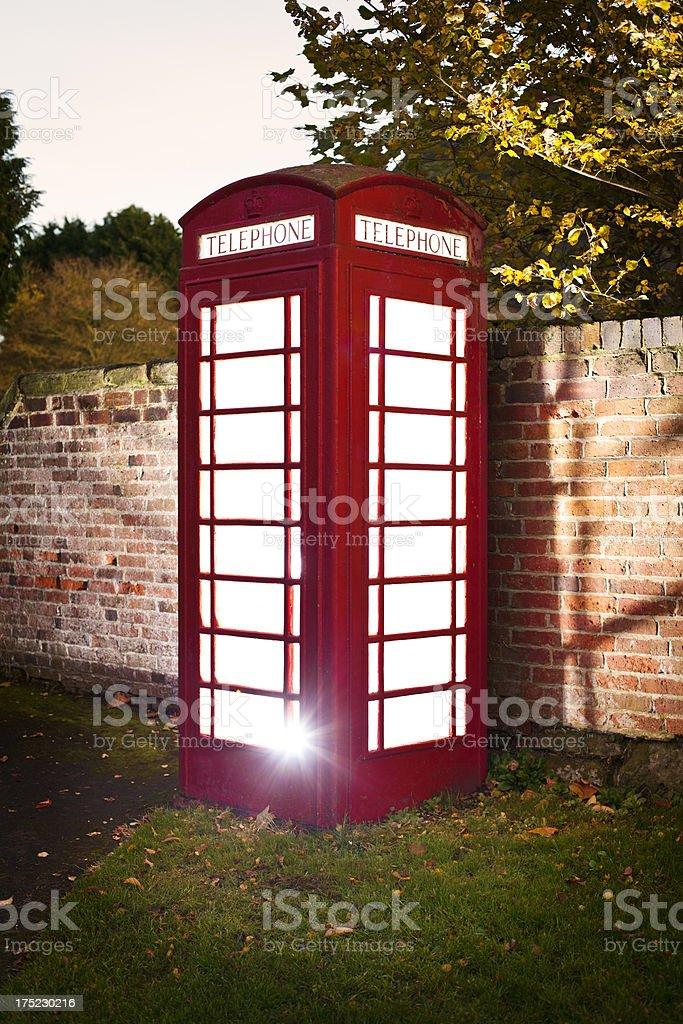 Glowing red british phonebox royalty-free stock photo