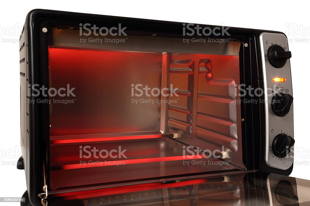 Glowing red heating elements in electric oven stock photo
