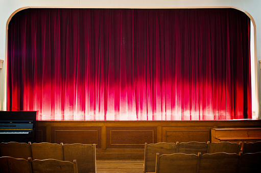 Glowing red stage curtain