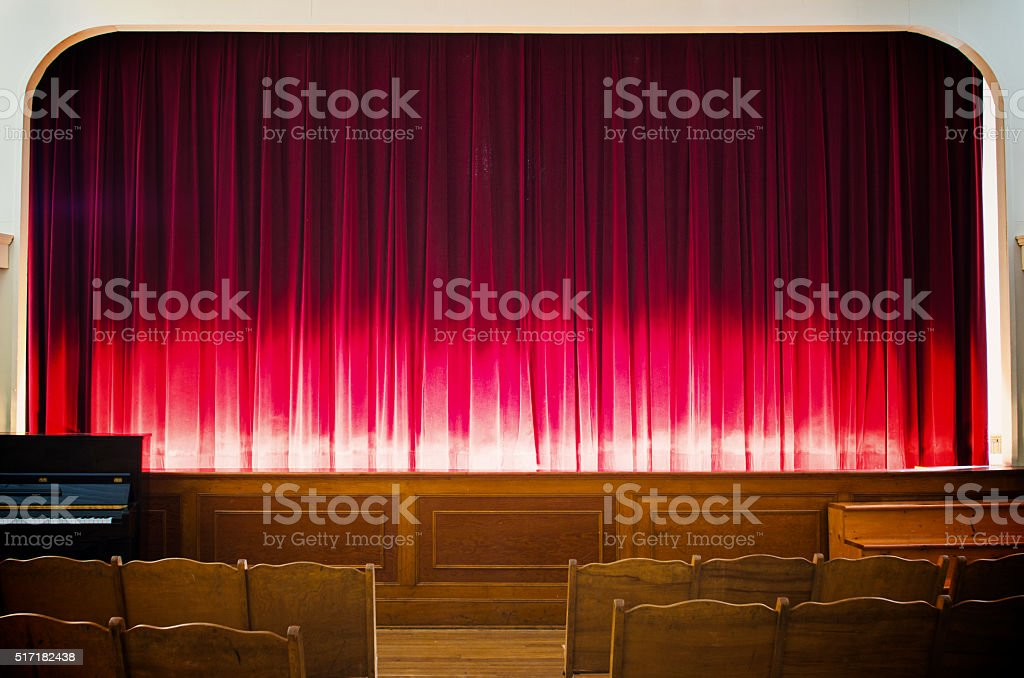 Glowing red stage curtain stock photo