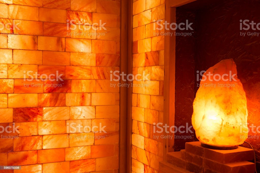 Glowing salt lamp and Himalayan salt bricks stock photo