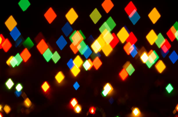 A glowing shape diamonds colored on a black background stock photo