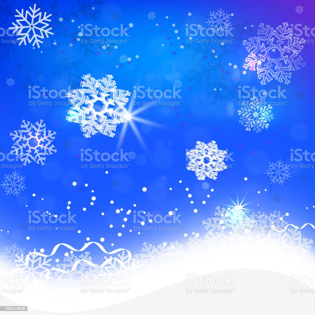 glowing snowflakes on a blue background snow - foto stock