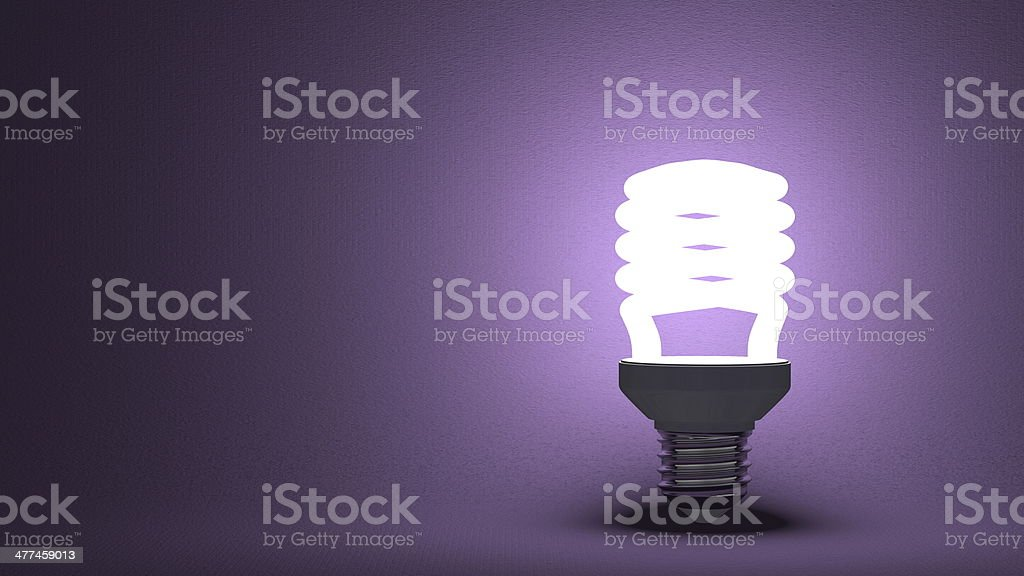 Glowing spiral light bulb on violet stock photo