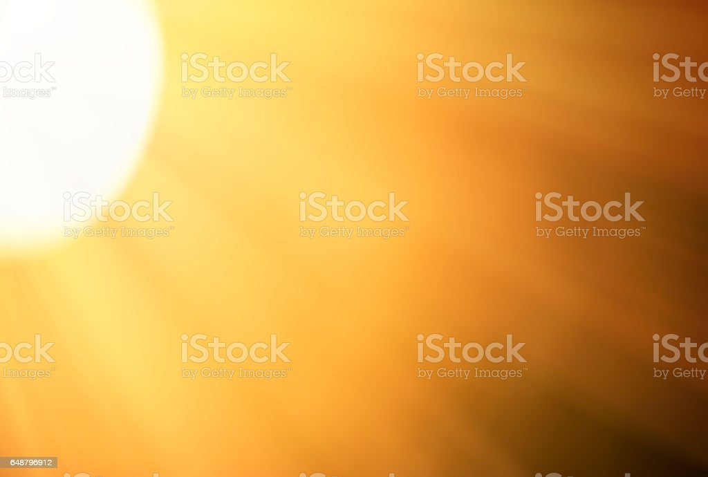 Glowing sun disc on the edge with light bokeh background stock photo