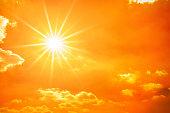 istock Glowing sun on orange sky 1257088461
