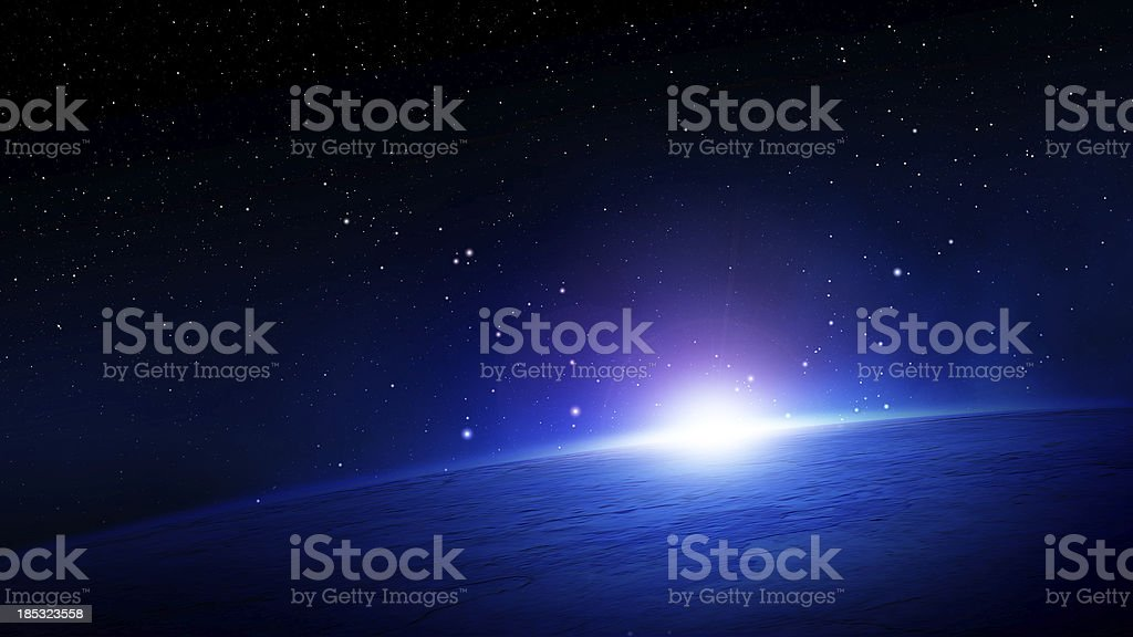 Glowing sunlight over the horizon on Planet Earth in space stock photo