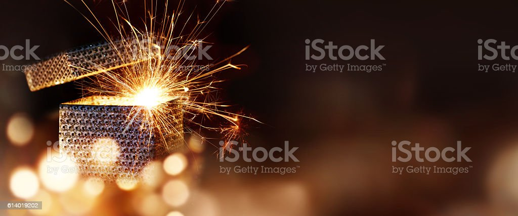 Glowing surprise package stock photo