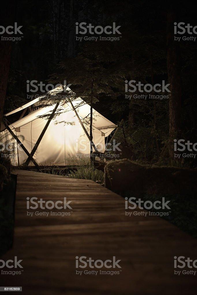 Glowing tent at night. royaltyfri bildbanksbilder