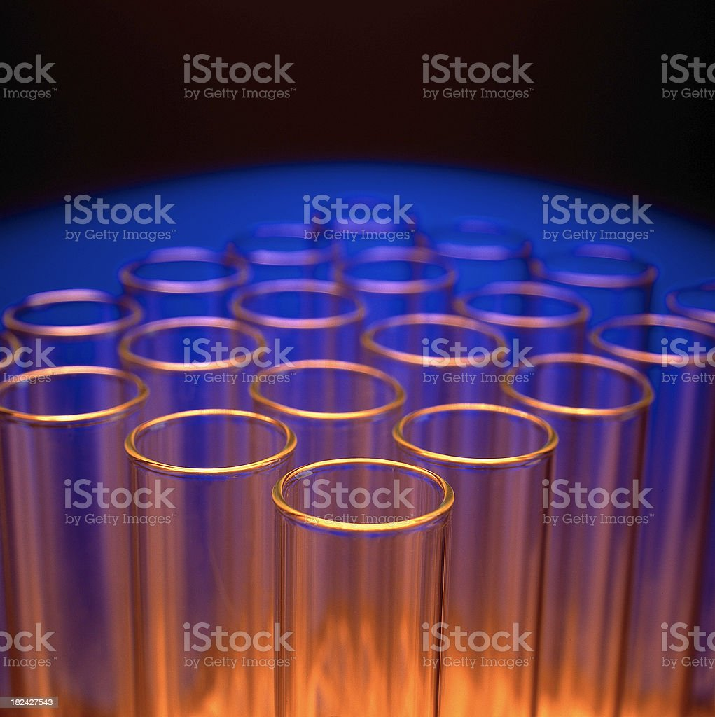 Glowing Test Tubes in laboratory environment stock photo