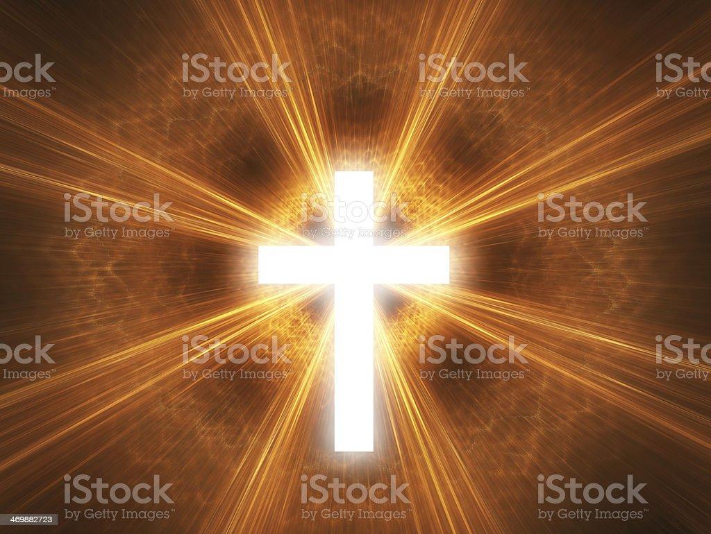 Glowing white cross on orange background stock photo