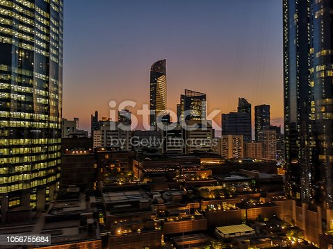 istock Glowing windows of skyscrapers at sunset - View of modern offices and towers, Abu Dhabi 1056755684