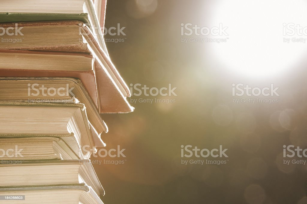 Glowing wisdom gained from stack of books royalty-free stock photo