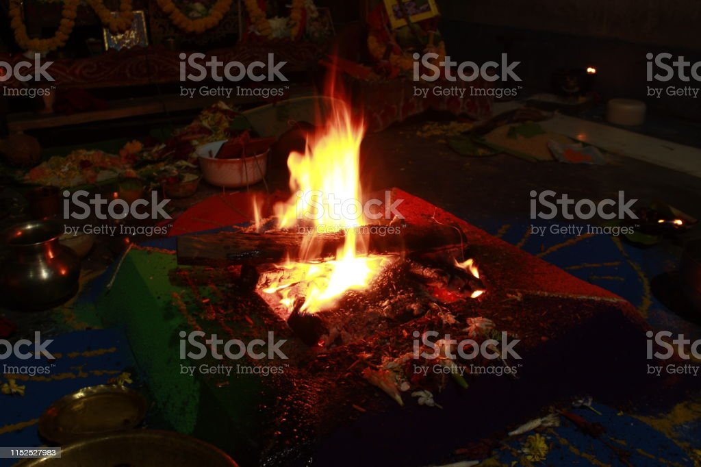 Glowing Yellow and orange colour fire is flamming and burning on a...