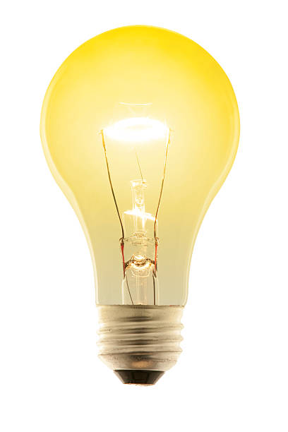Glowing Yellow Incandescent Light Bulb. Isolated on White with Path stock photo