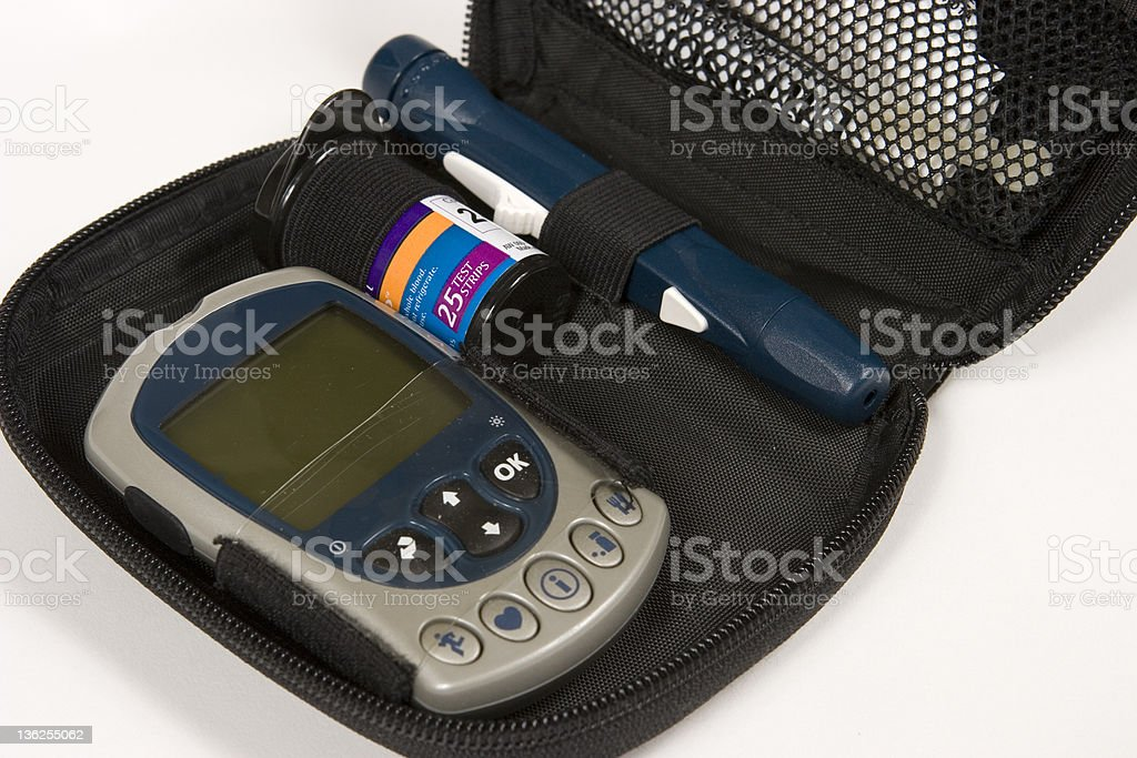Glucometer and case royalty-free stock photo