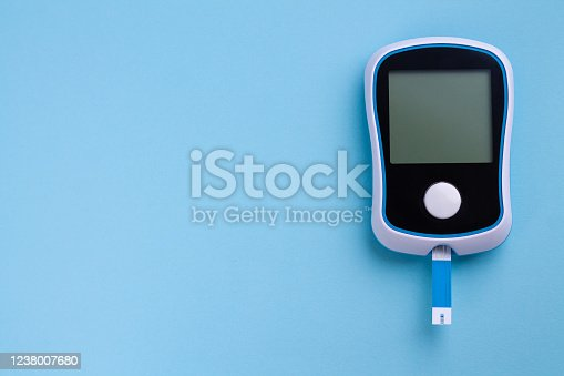 istock Glucometer for diagnosis Diabetes close-up. Monitoring sugar or insulin in blood level with copy space 1238007680