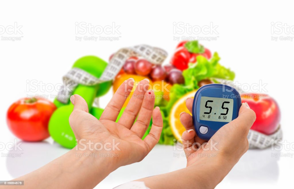 glucometer for glucose level and healthy organic food on a white background. Diabetes concept stock photo