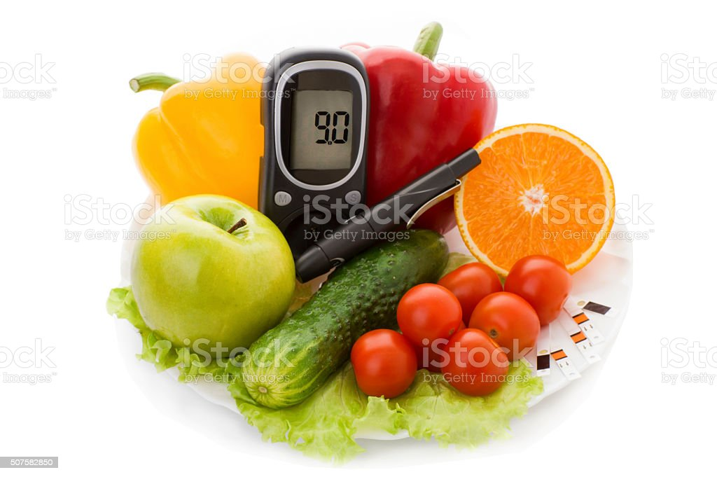 glucometer for glucose level and healthy organic food stock photo