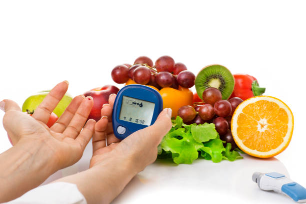 glucometer for glucose level and healthy organic food glucometer for glucose level and healthy organic food on a white background. Diabetes concept hypoglycemia stock pictures, royalty-free photos & images