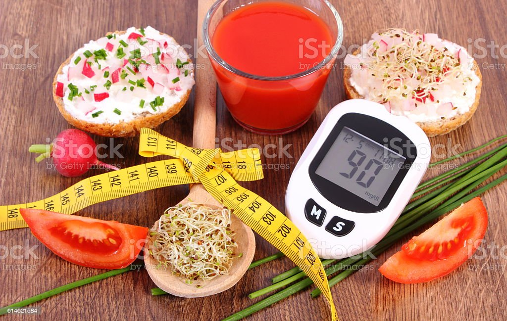 Glucometer, freshly sandwich, tomato juice and centimeter, diabetes, healthy nutrition stock photo