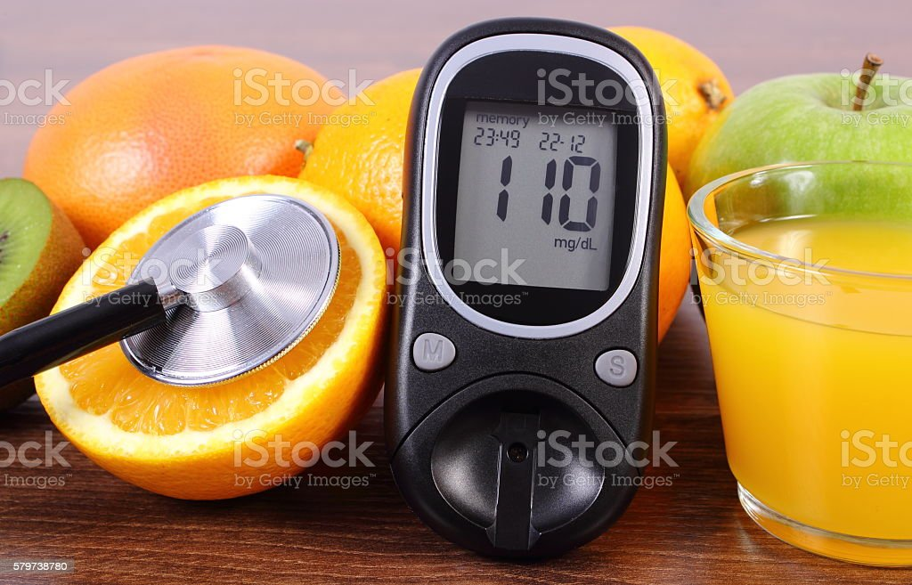 Glucometer, stethoscope, fruits and juice, diabetes, healthy lifestyles and nutrition stock photo