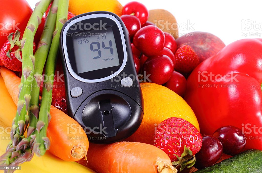 Glucometer with fruits and vegetables, healthy nutrition, diabetes - Royalty-free 2015 Stock Photo