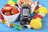 istock Glucometer with sugar level, healthy food, dumbbells and centimeter 636450462