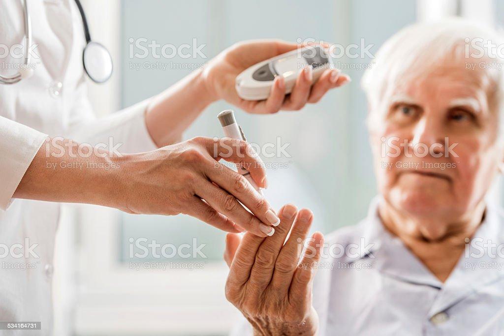 Glucose level blood test. stock photo