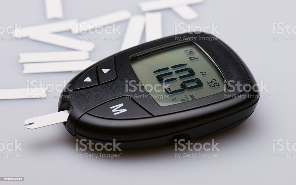 Glucose meter device with digital panel stock photo