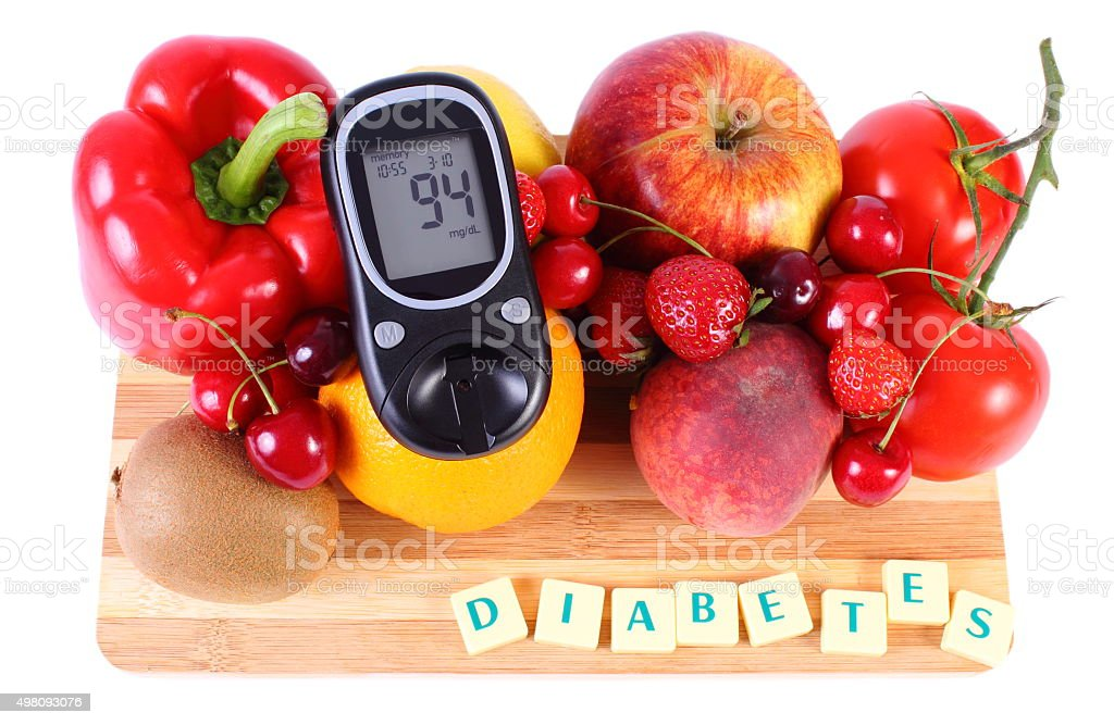 Glucose meter with fruits and vegetables, healthy nutrition, diabetes stock photo