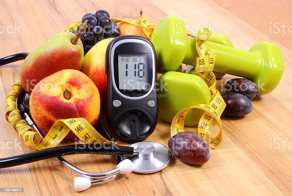 Glucose großen mit medizinische Stethoskop, Obst und Hanteln - Lizenzfrei 2015 Stock-Foto