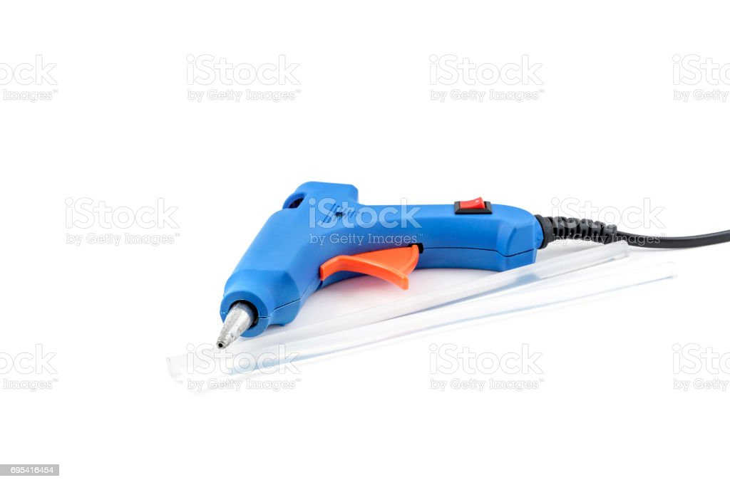 Glue gun with glue rods on a white background. stock photo