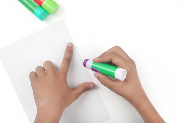 glue stick with hand - appiccicoso foto e immagini stock