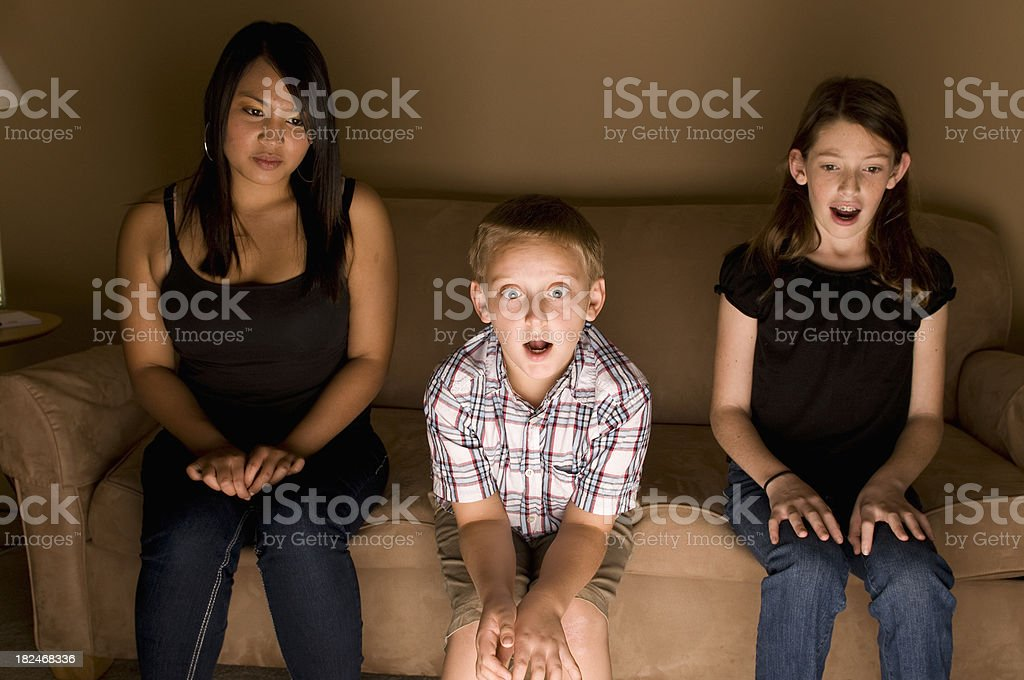 Glued to the TV royalty-free stock photo