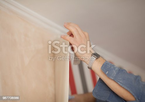 istock Glueing wallpapers at home. 987708586